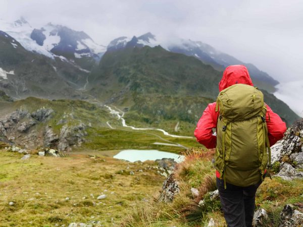 36325106 – hiking – hiker woman on trek with backpack living healthy active lifestyle. hiker girl walking on hike in mountain nature landscape in steingletscher, urner alps, berne, swiss alps, switzerland.